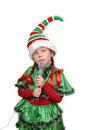 Girl santas elf with a microphone isolated on white background Stock Photography