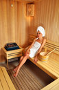 Girl in sauna with a towel on head Stock Image