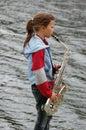 Girl with saxophone Stock Photos