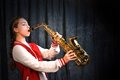 Girl with saxophone Royalty Free Stock Photo