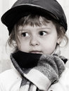 Girl in a scarf and cap looking black white Royalty Free Stock Image
