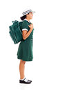 Girl school bag side view of young teenage carrying her backpack looking up Stock Photos