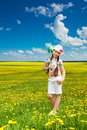 Girl with scoop net portrait of happy years old in the park when dandelions are blooming Stock Photography