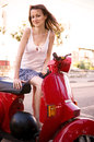 Girl on the scooter cute while climbing motorcycles Royalty Free Stock Image