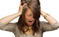 Girl screaming with hands on head shouting her the hair Stock Photography