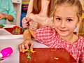 Girl sculpt of plasticine on desk in happy little kindergarten Stock Images