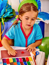 Girl sculpt of plasticine on desk in little kindergarten Royalty Free Stock Photo