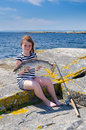 Girl sea fishing adorable with big silver trout Royalty Free Stock Photo