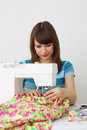 Girl seamstress and sewing machine Stock Image