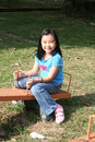Girl on seesaw Stock Images