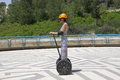 Girl on Segway - a modern transport Royalty Free Stock Images