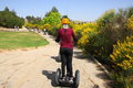 Girl on Segway - a modern transport Stock Images