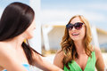 Girl in shades in cafe on the beach summer holidays and vacation Royalty Free Stock Images