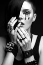 Girl with shaved head in art gothic style with black paint on his face and gothic accessories picture taken the studio a Stock Images