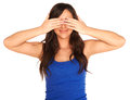 Girl in a shirt and skirt covering her eyes isolated Royalty Free Stock Photo
