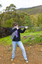 Girl shooting airgun Royalty Free Stock Photo