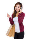 Girl with shopping bag and talk to cellphone asian woman isolated on white Stock Photos