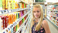 Girl shopping for beauty products young stood in supermarket store aisle Stock Photos
