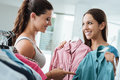 Girl shopping a choosing a shirt at the store Royalty Free Stock Photo