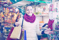 Girl shopping at festive fair before Xmas in evening time