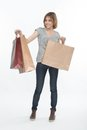 Girl and shopping full length portrait of pretty fair haired smiling boasting of her purchases isolated on the white background Royalty Free Stock Images
