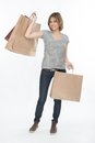 Girl and shopping full length portrait of pretty fair haired smiling boasting of her purchases isolated on the white background Stock Photo
