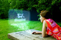Girl shopping on-line in park Royalty Free Stock Photo