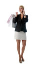 Girl after shopping speaking by mobile phone. Royalty Free Stock Photos