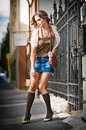 Girl short skirt and bag walking on street young european girl in urban setting sexy woman dressed provocatively posing Royalty Free Stock Photography
