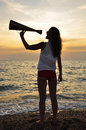 Girl shouting into a megaphone Stock Photo