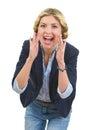 Girl shouting through megaphone shaped hands