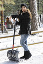 Girl shoveling snow a beautiful Royalty Free Stock Image