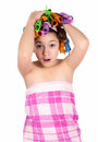 Girl after shower in curlers Stock Image