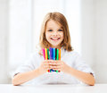 Girl showing colorful felt tip pens education and school concept little student at school Royalty Free Stock Photography