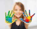 Girl showing painted hands education school art and painitng concept little student Stock Image