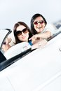 Girl showing something out of the white car to her driving friend Royalty Free Stock Photography
