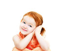 Girl showing it is time to sleep cute smiling little with red hair with her hands near cheek isolated on white Stock Image