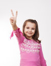 Girl showing victory sign with her hand Stock Image