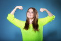 Girl shows her muscles strength and power woman long hair clenching fists blue background concept Royalty Free Stock Photography