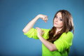 Girl shows her muscles strength and power young woman blue background concept Stock Image