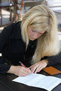 The girl signing the contract Royalty Free Stock Photography