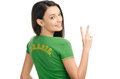 Girl signing victory for brazil attractive with brasil written on her green t shirt isolated on white Royalty Free Stock Photography