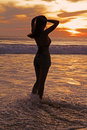 Girl silhouette of standing in the see water in the sunset Royalty Free Stock Photo