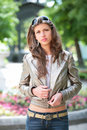 Girl in silvery jacket Stock Images