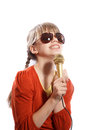 Girl sing sings emotionally into the microphone on a white background Royalty Free Stock Photo