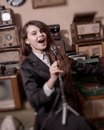 Girl singing in antique shop young with old microphone stand Stock Images