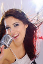 Girl singing in retro mic Royalty Free Stock Photography
