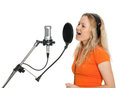 Girl singing with studio microphone Royalty Free Stock Photo