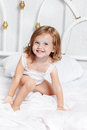 Girl sits in bed Royalty Free Stock Images