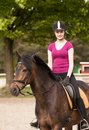 Girl sits on her pony brown new forest Stock Photos